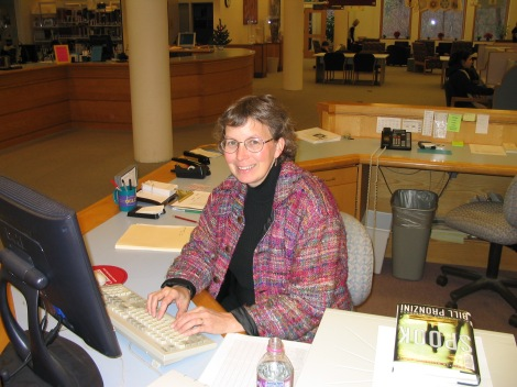 Connie G at desk