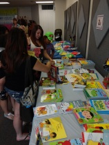 Attendees choose books to take home to enjoy with their children